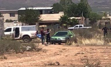 Encuentran ejecutado en vehículo en Granjas del Valle